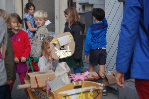 The children touring Mr. Wiels through the streets of Brussels